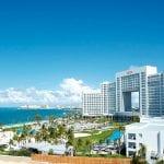 ¿Cómo puedo llegar al hotel Riu Palace en Cancún desde el aeropuerto?